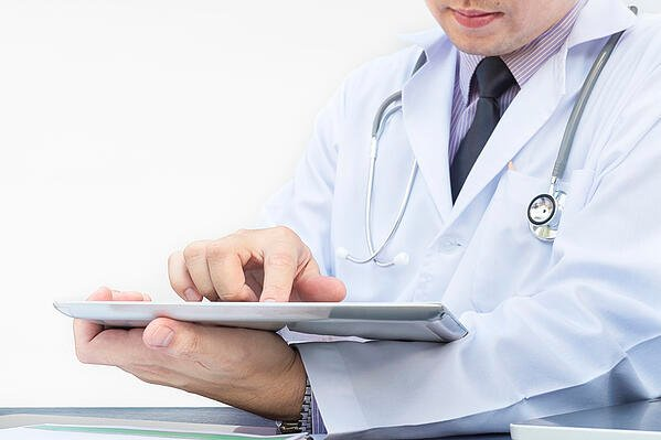 doctor-is-working-with-tablet-white-background