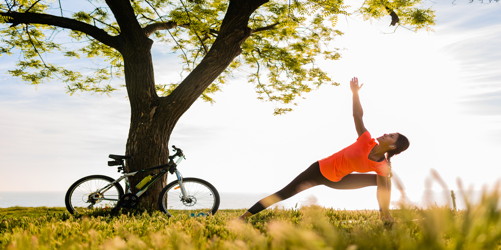 slim-beautiful-woman-silhouette-doing-sports-in-morning-in-park-doing-yoga