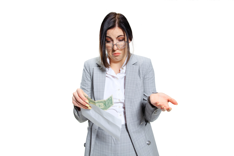 young-woman-in-grey-suit-getting-small-salary-and-not-believing-her-eyes-shocked-and-outraged-concept-of-office-worker-s-troubles-business-problems-and-stress